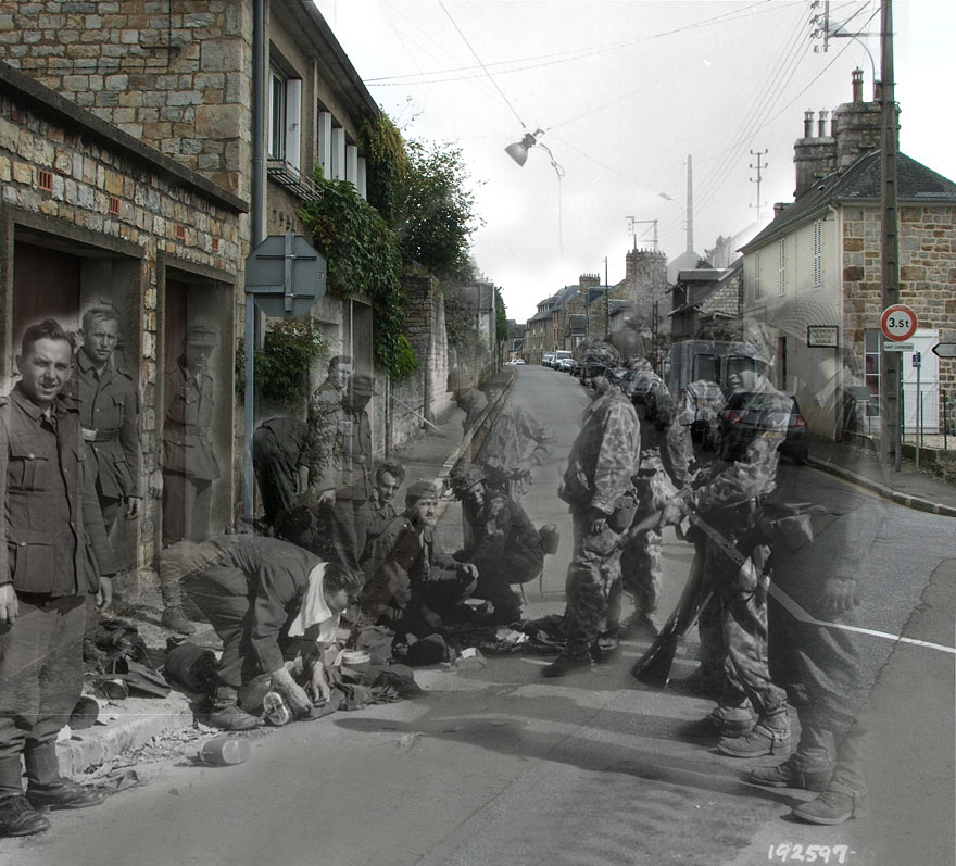 """France, 1944. Rue des Fossés Plissons à Domfront (Orne). German soldiers surrendering."""