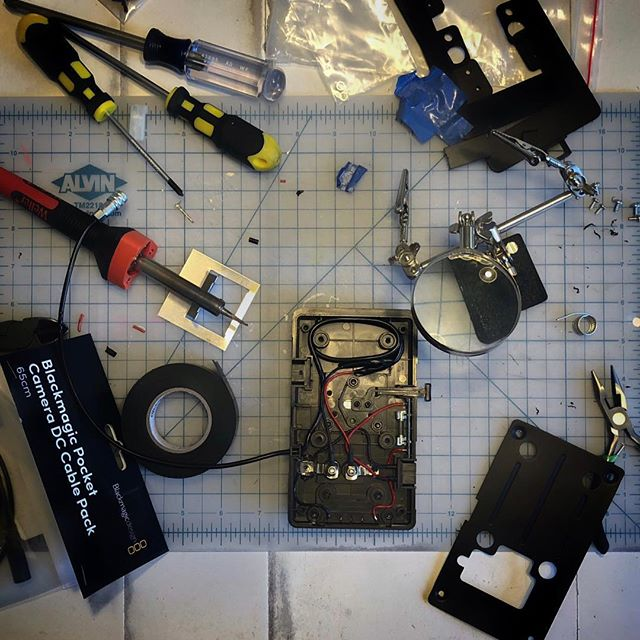 "🌧 Rainy day soldering in a ""custom"" hardwired 2-pin Weipu connection to a CoreSWX V-mount plate for the Blackmagic Pocket Cinema Camera 4K. . . . #switronix #coreSWX #blackmagicdesign #weipu #bmpcc4k #dtap #antonbauer #vmount #soldering #idx #bmpcc #cinema #electronics #cinemacamera #cameragear #camerarigs #camerarigz"