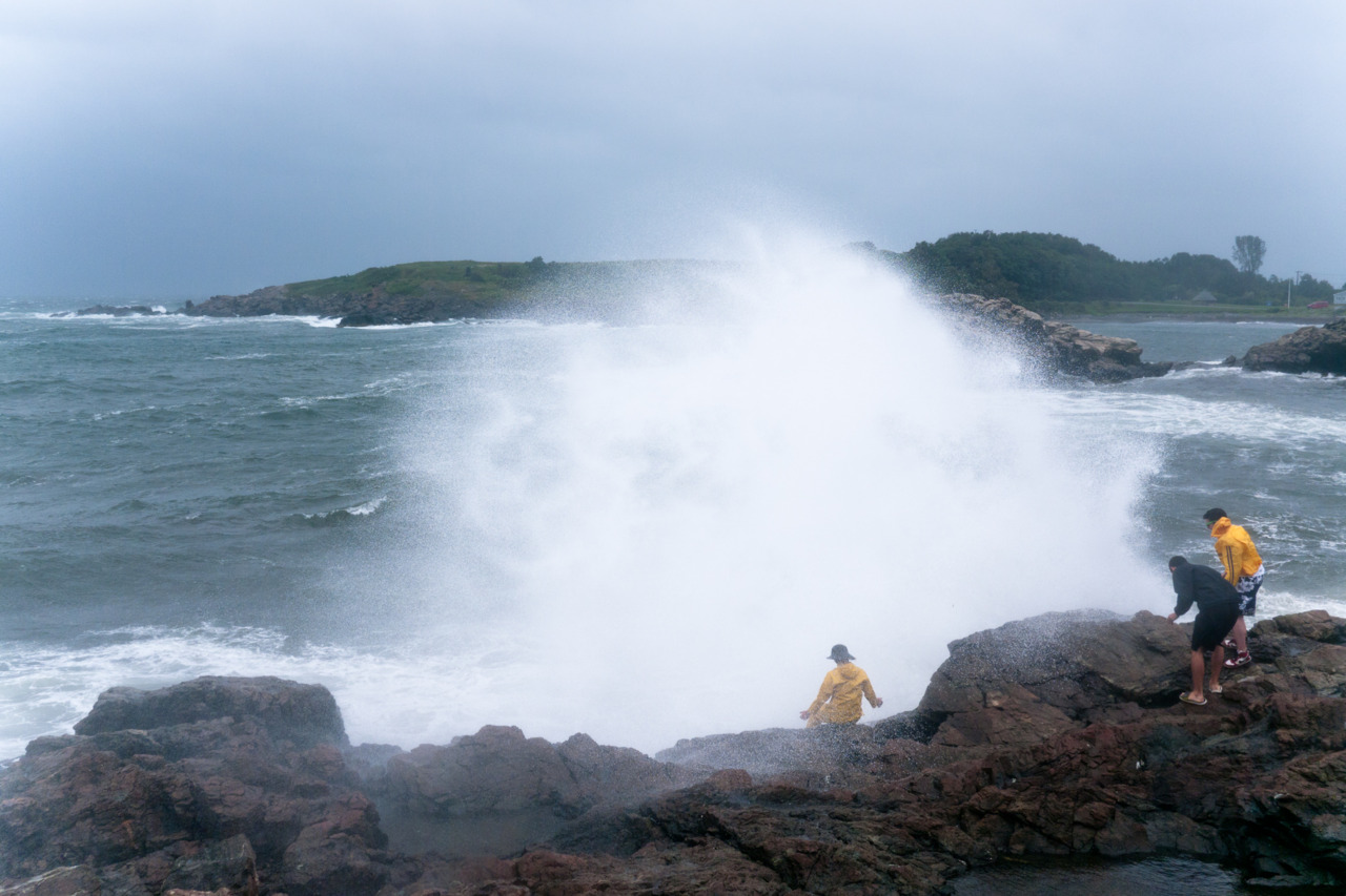 Piers gets engulfed by a wave from Hurricane Irene.