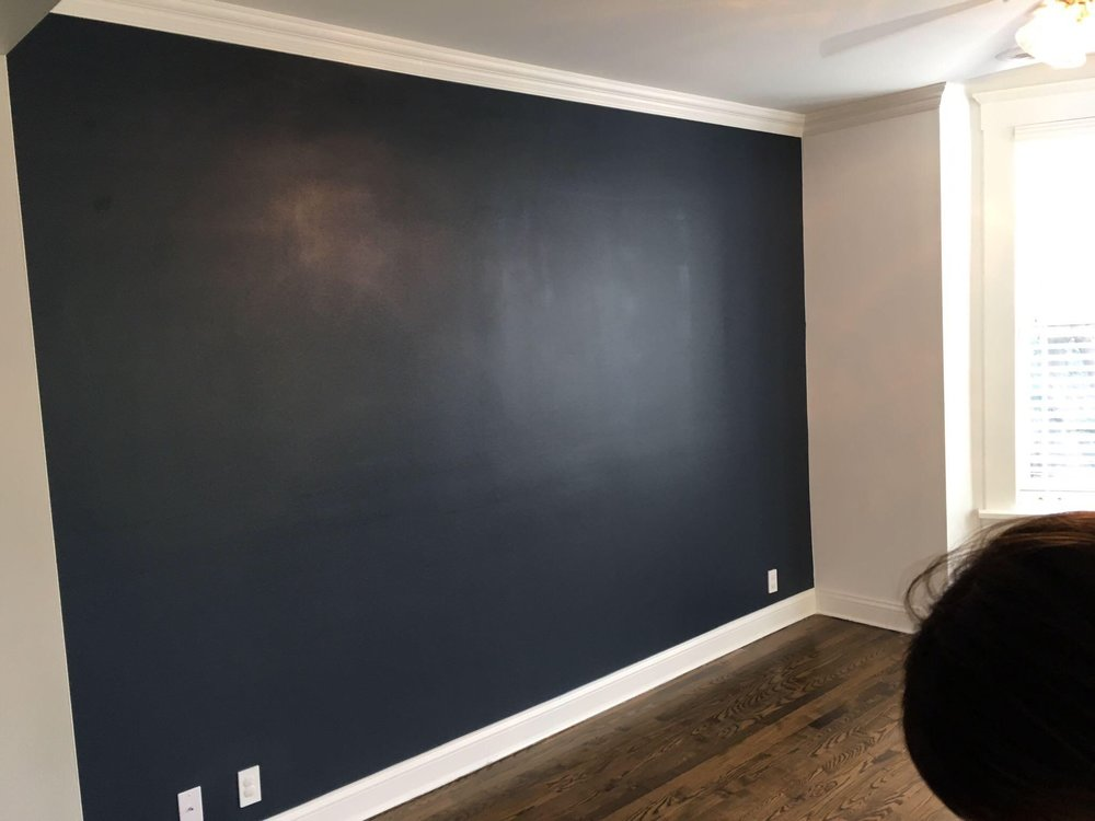 To switch it up we decided to go with a navy (Hale Navy by Benjamin Moore) accent wall in the living room. It adds the perfect amount of depth and drama.