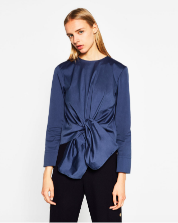 Zara Poplin Top with Knot   - $49.90  This top makes a definite statement! I'll be wearing it to work and date night. Again, I think this will pair beautifully with the black trousers (and boots!) below for a more dressed up look and with a distressed boyfriend jean to keep it casual.