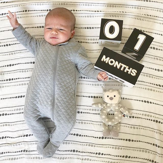 "1 month young (already a couple days late - I'm SO terrible at monthly pictures so I'm sure this will be the first of many ""late"" posts.) You are a champion eater weighing in at 10 lbs. 8 oz., you love baths, you grunt all night long but sleep in impressive 3-4 hour stretches, and you love a good crinkle toy. You complete us and we love loving you!"