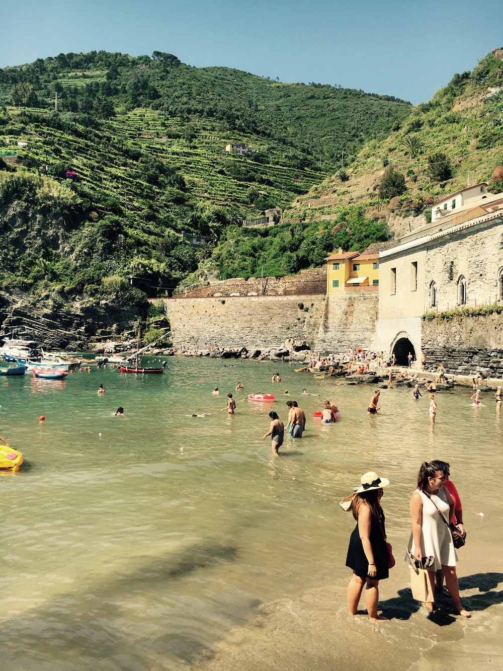 People swimming in Vernazza, Cinque Terre, Italy