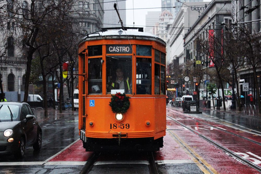 December 21, 2015. Market Street, San Francisco, CA. Orange Muni to Castro on a rainy day.