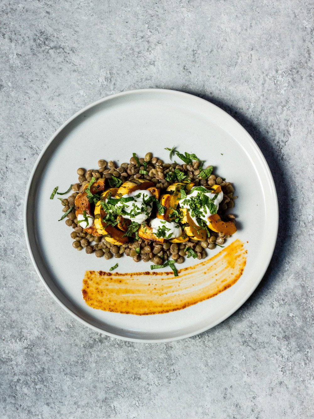 Harissa-Cumin Roasted Delicata Squash over Lentils, Yogurt + Mint