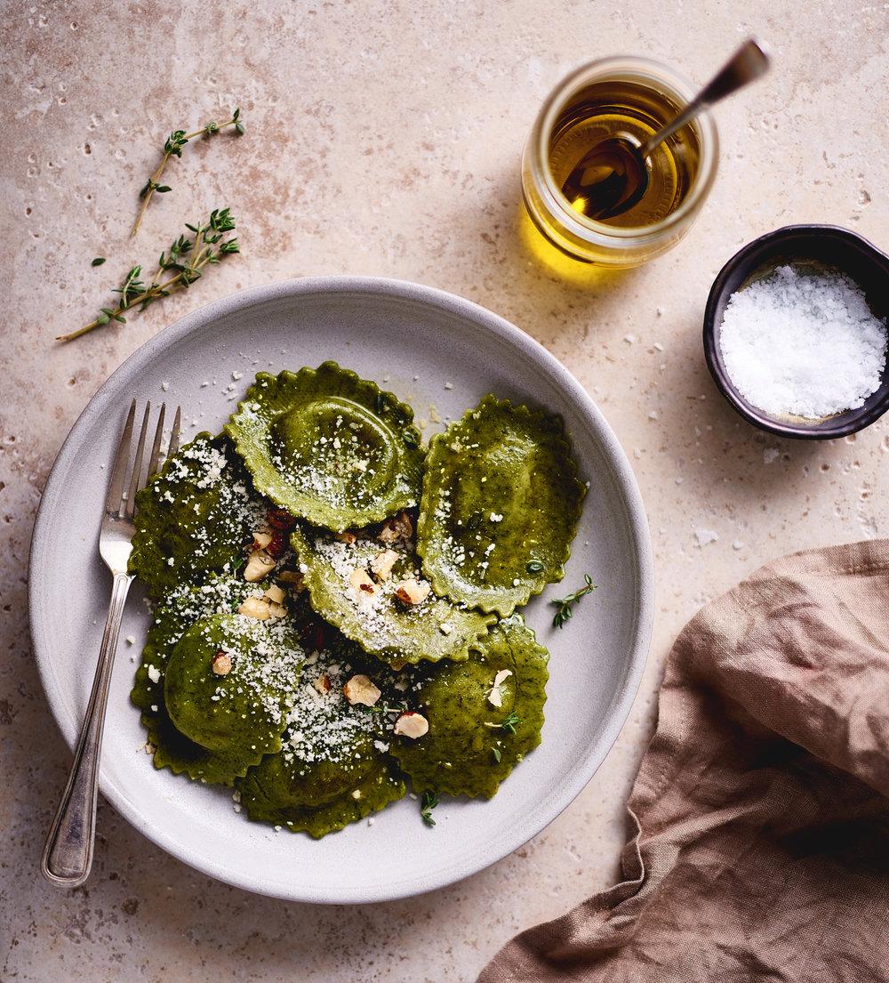 Spinach + Artichoke Ravioli w/ thyme, parm, hazelnuts