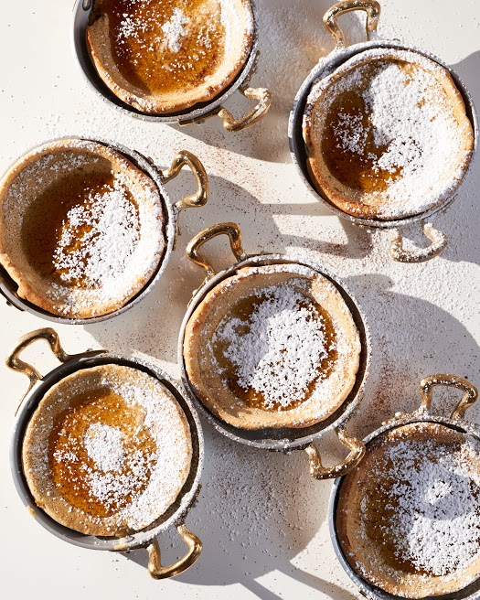 Eggnog Dutch Babies with powdered sugar + maple syrup. Very festive, very good!