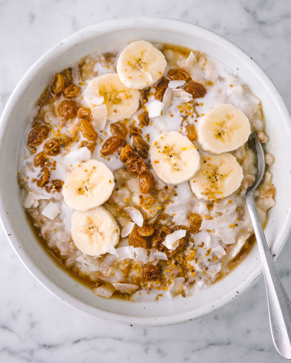 multi grain porridge with coconut and poached raisins
