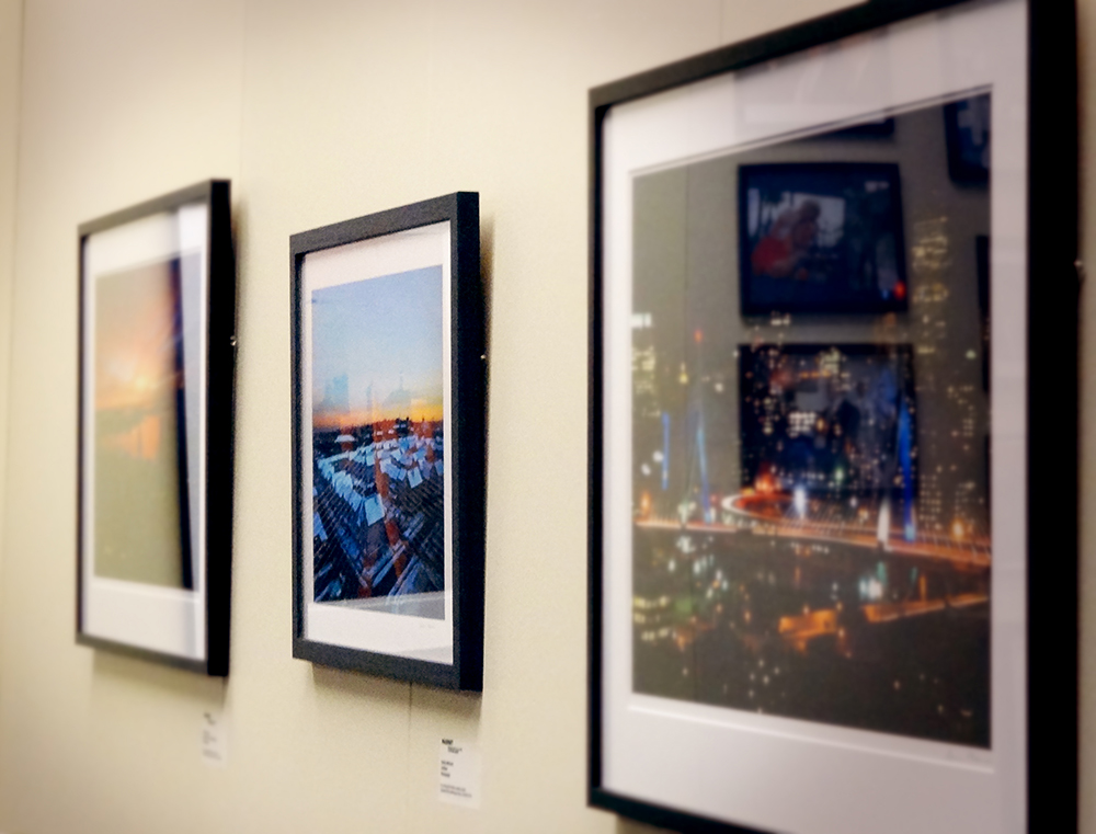 Boston photography hanging in Secretary of Education Matt Malone's office, 2013. Geena Matuson's (@geenamatuson) photograph hands in the middle of the three images.