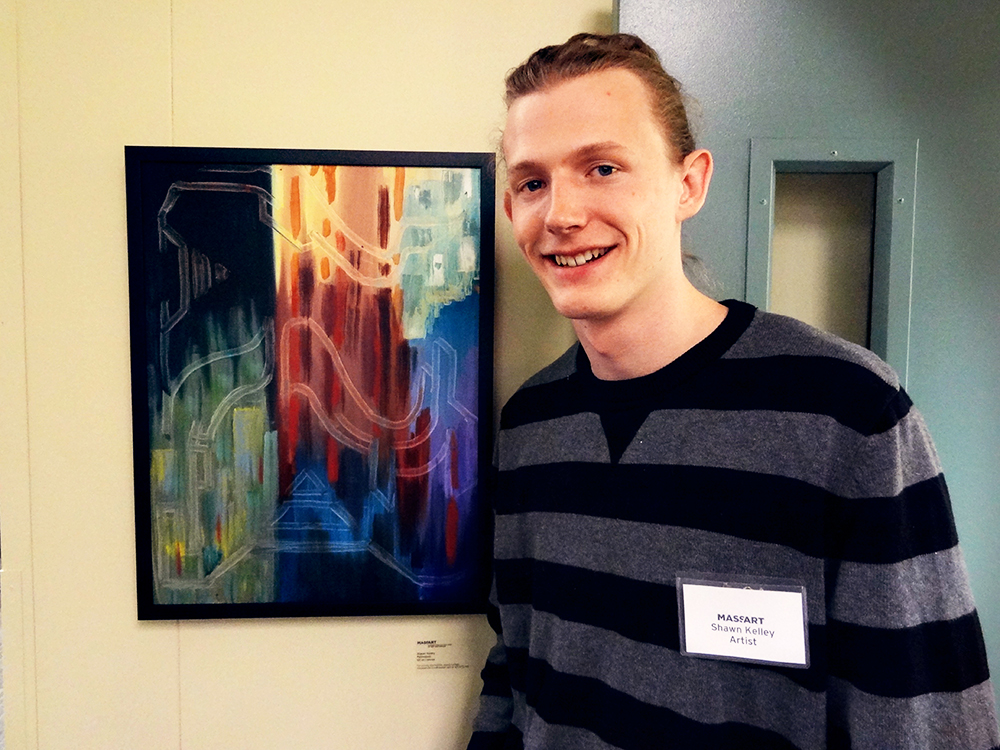 Shawn Kelley beside his work, 2013.
