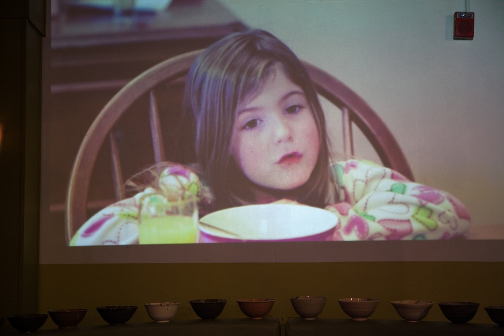 Geena Matuson's (@geenamatuson) film 'Ice Cream for Breakfast' projected on wall at RAW Artists 'Revolution' event, 2014.