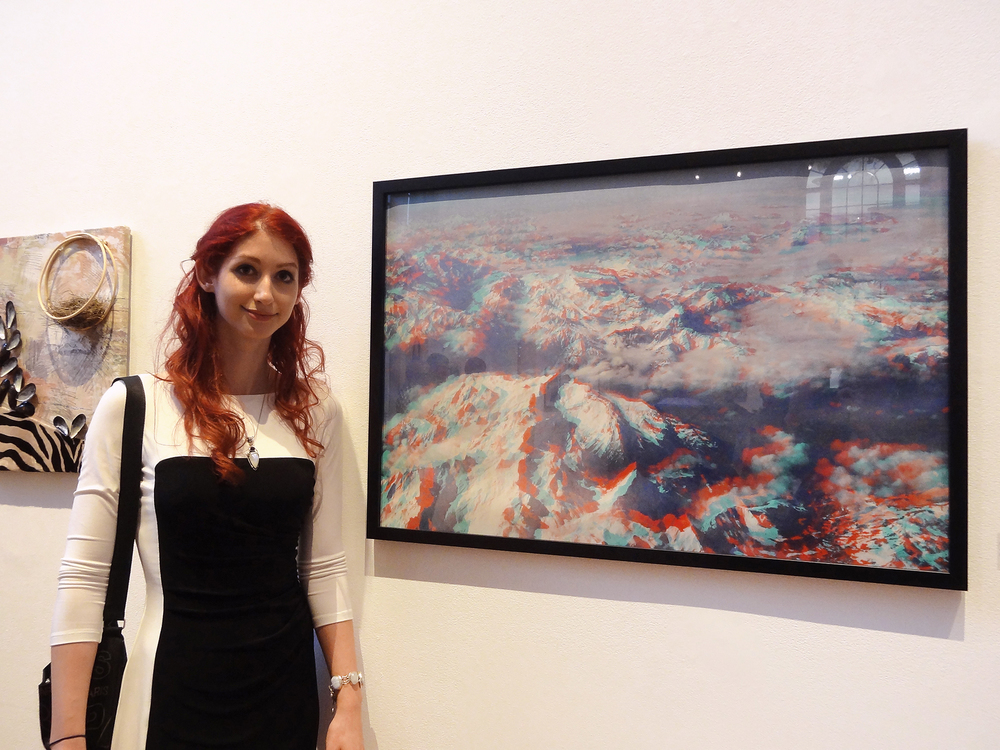 Geena Matuson and her framed work 'Alps in 3D' in MassArt Graduating Senior Exhibition, 2013.