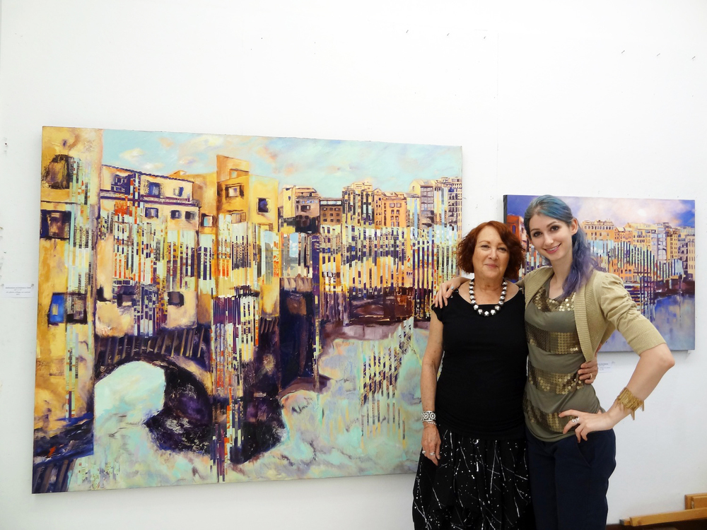 Artist Dee Cohen stands before her work, part of her 'Time In Oscillation' series, with artist Geena Matuson (@geenamatuson), 2014.