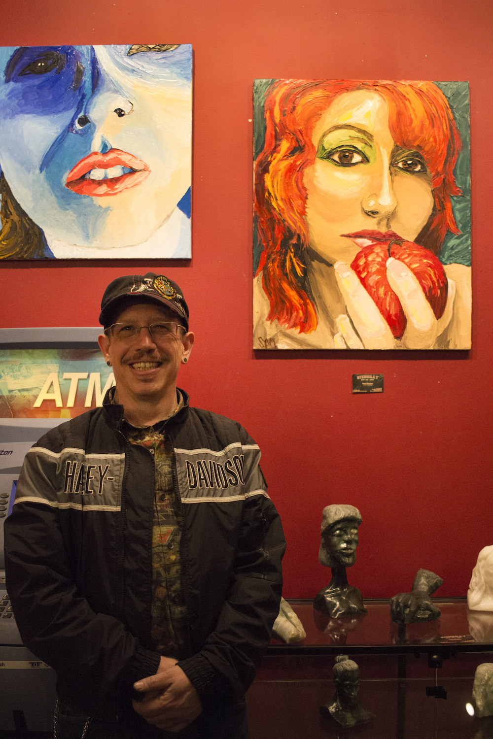 Scott Matalon stands before his paintings at The Stingray Body Art Tattoo Artist Art Show, March 2016.