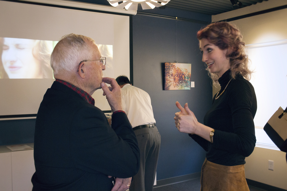 Tom Sweeney with Geena Matuson at her solo show reception at Medfield TV. April, 2016.