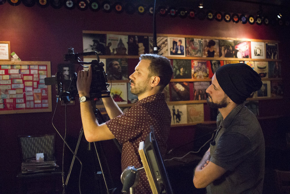 Director of Photography Denez McAdoo with Assistant Camera Dylan Kiely on the set of Geena Matuson's production of 'Fauxmercials' bar ads, September 2016.