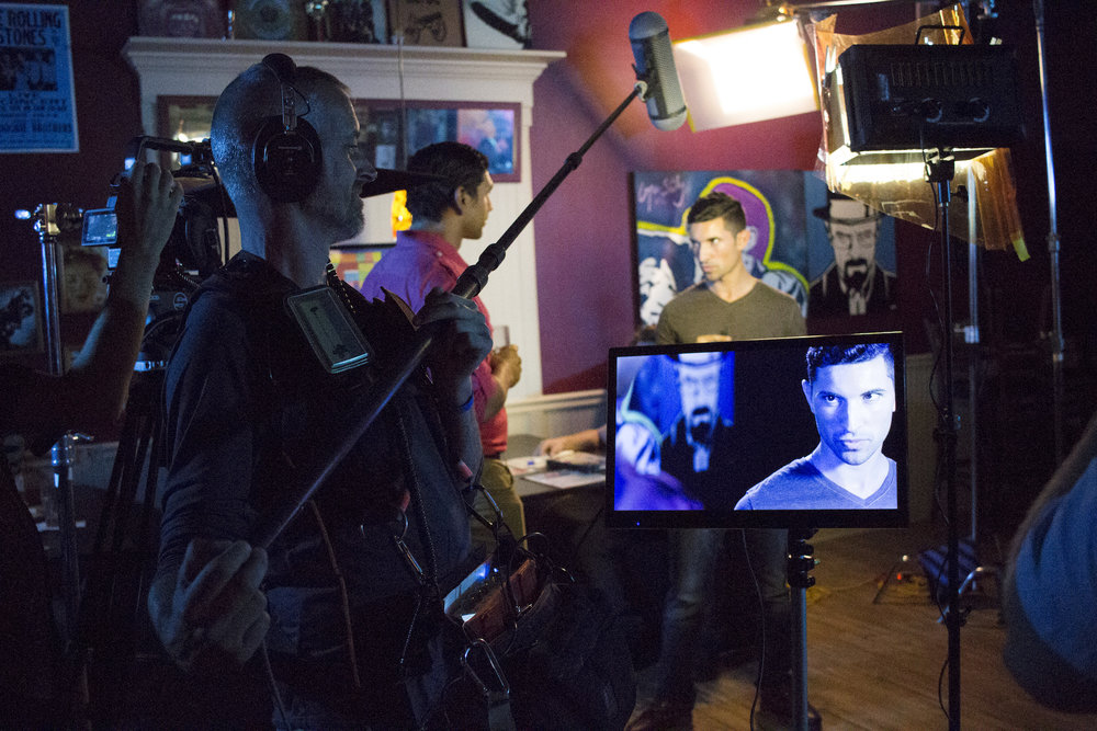 Audio Djim Reynolds captures dialogue between Actors Casey William Hines and Andrew Morais on the set of Geena Matuson's production of 'Fauxmercials' bar ads, September 2016.