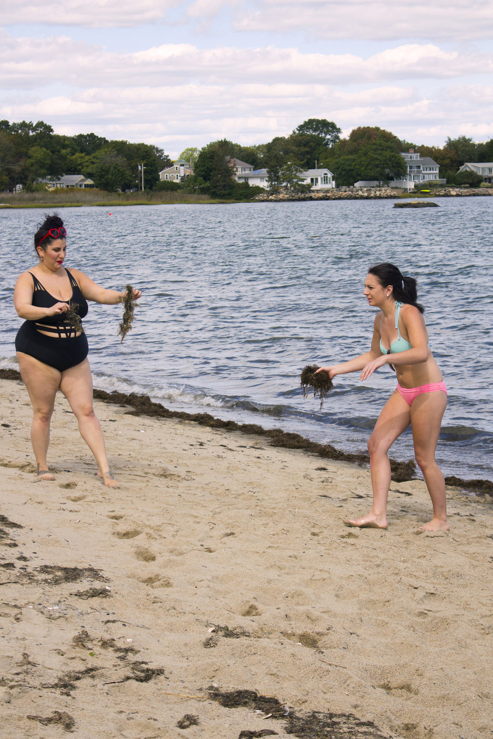 "Actors Alessandra Grima and Catalina Snape collect seaweed with which to ""pamper"" Geena Matuson on the set of her production for comedic 'beach ads,' part of her 'Fauxmercials' series filming through 2017."
