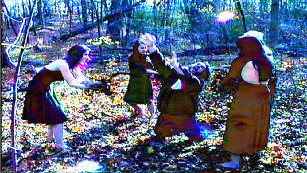 Set of  Reel Groovy Films  shoot featuring witches of Salem  Geena Matuson  (@geenamatuson),  Maya Simone ,  Eve Xastur  and Mima Huntington, enchanting the poor pilgrim villager Trevor Hart, 2016.