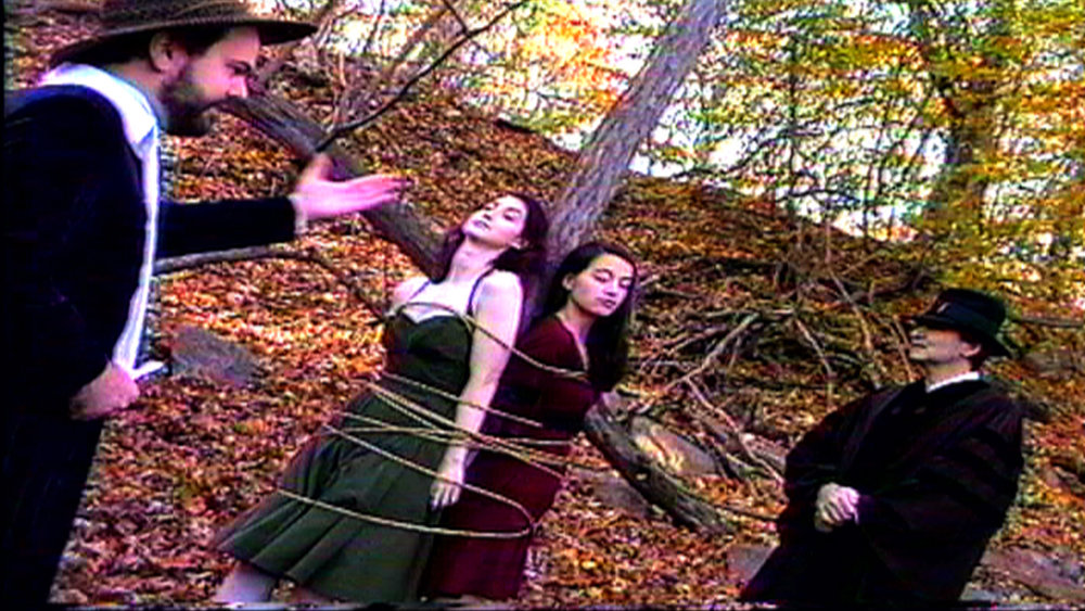 On the set of  Reel Groovy Films  shoot featuring witches of Salem  Geena Matuson  and  Maya Simone  who are offered their 'lost chonce' to confess, or burn. Pilgrims Dawn Nightshade and Caleb bear witness.