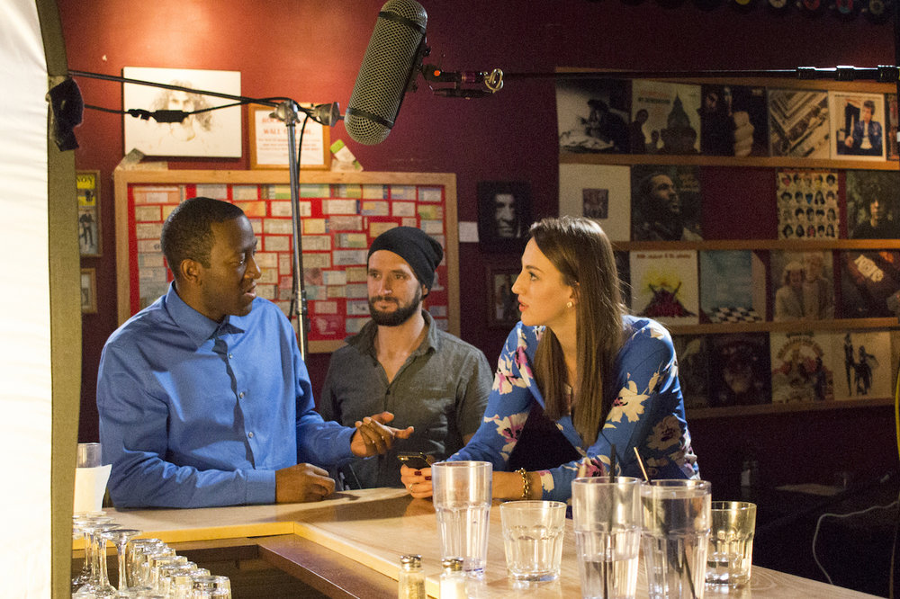 Actors  Jamaal Eversley  and Samantha Webb with Assistant Camera  Dylan Kiely  on the set of Geena Matuson's (@geenamatuson) production of 'Fauxmercials' bar ads, September 2016.