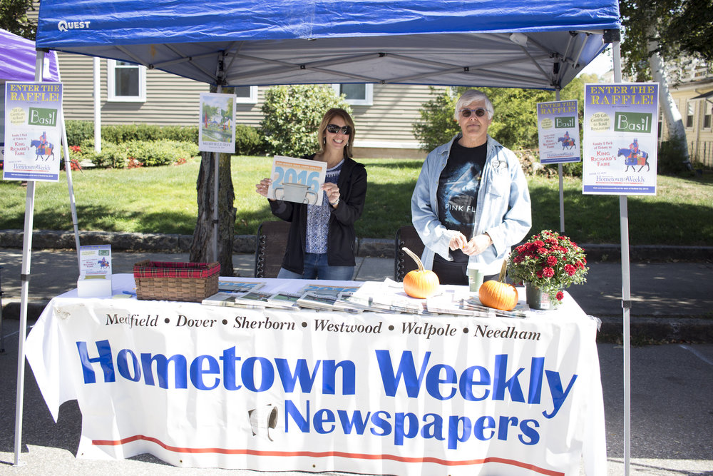 Maria LaRose and Mike DeSario of Hometown Publications showcase the latest edition of the paper, moving into its 20th year.