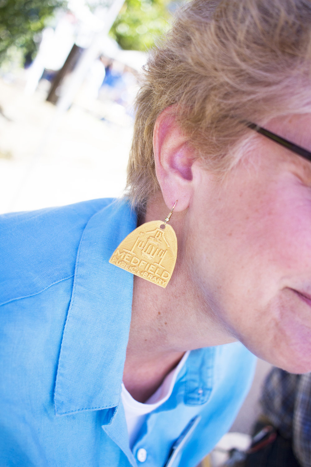 Amazing 3D-printed earrings adorned Library Director Kristen Chin.