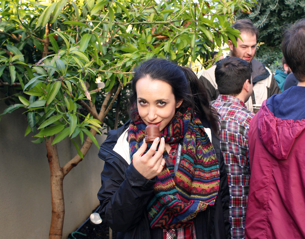 Group leader Rebecca Gold seductively plies a chocolate treat in the backyard of Nir's family home in Hadera, celebrating the second night of Hanukkah with Shorashim Israel, 2016.