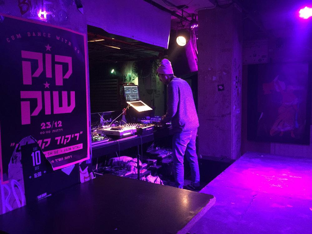 DJ at Tel-Aviv's club  Pasáž (Passage) , voted one of the world's best bars.