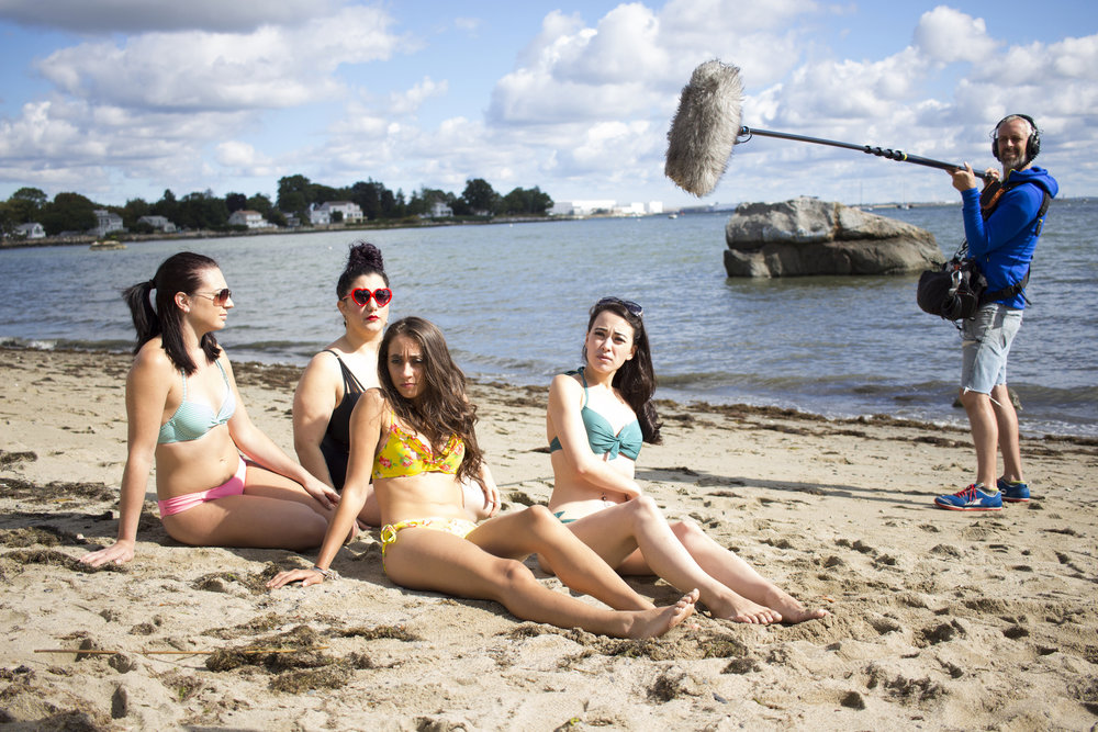 Left to right: Actors Catalina Snape, Alessandra Grima, Acei Martin and Maya Simone with Audio Djim Reynolds on the set of Geena Matuson's production of 'Fauxmercials' beach ads, September 2016.