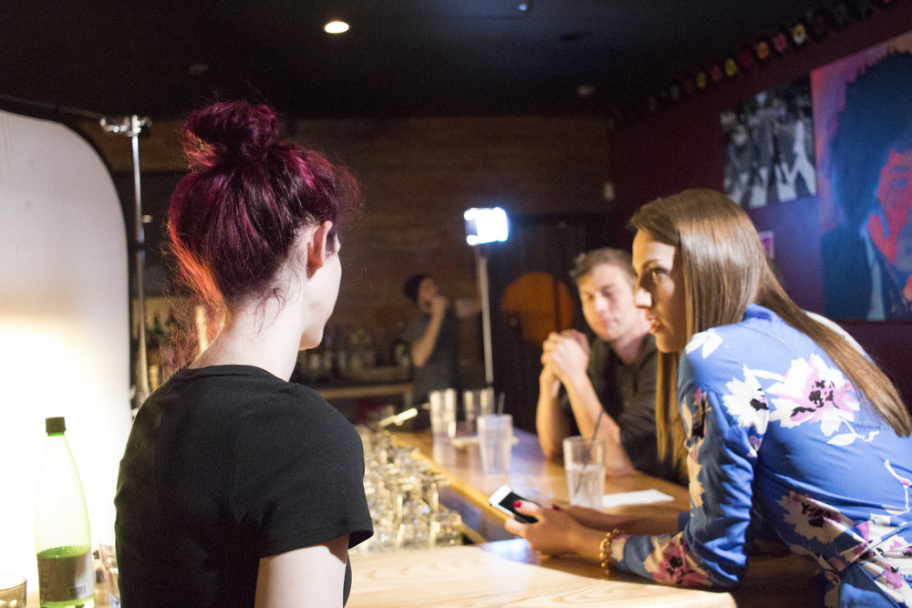 Writer, Producer/Director Geena Matuson (@geenamatuson) speaks to actors prior to filming on the set of her production of 'Fauxmercials' bar ads, September 2016.