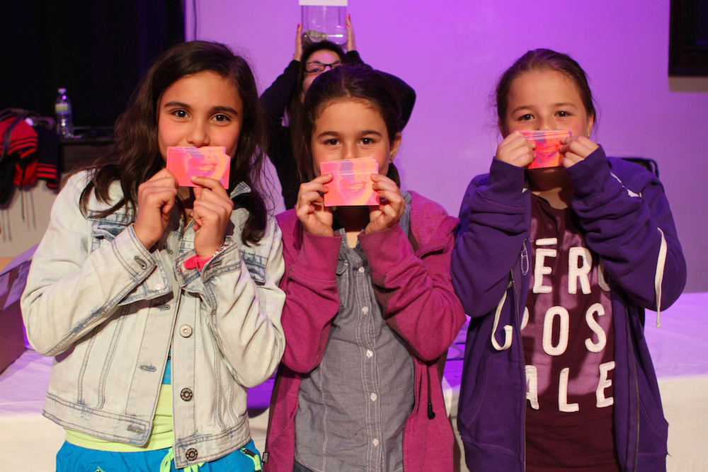 Kids playing with the lips-themed business cards at the premiere of Geena Matuson's (@geenamatuson) thesis film 'My Big Bad Wolf,' 2013.