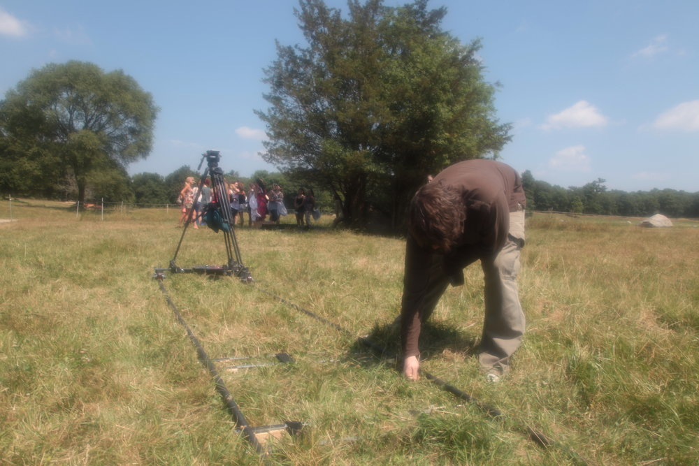 Assistant Rick Desilets helps align the track in the grass on the set of Geena Matuson's (@geenamatuson) thesis film 'My Big Bad Wolf', 2013.