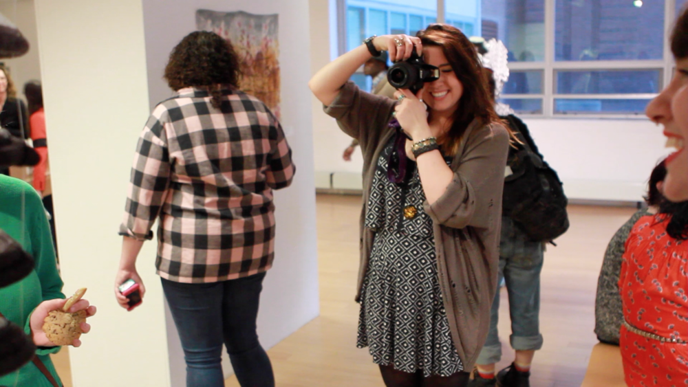 Artist Sydney Schofield behind the camera at Geena Matuson's (@geenamatuson) TransFIREmation Gallery Show & Installation in the MassArt Student Life Gallery, 2013.