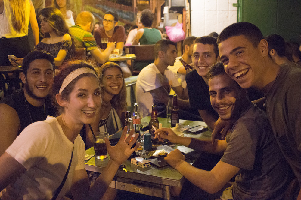 Geena Matuson (@geenamatuson) with random group of Israelis who wanted a photo with her at a restaurant in Rishon LeZion, Israel, September 2017.