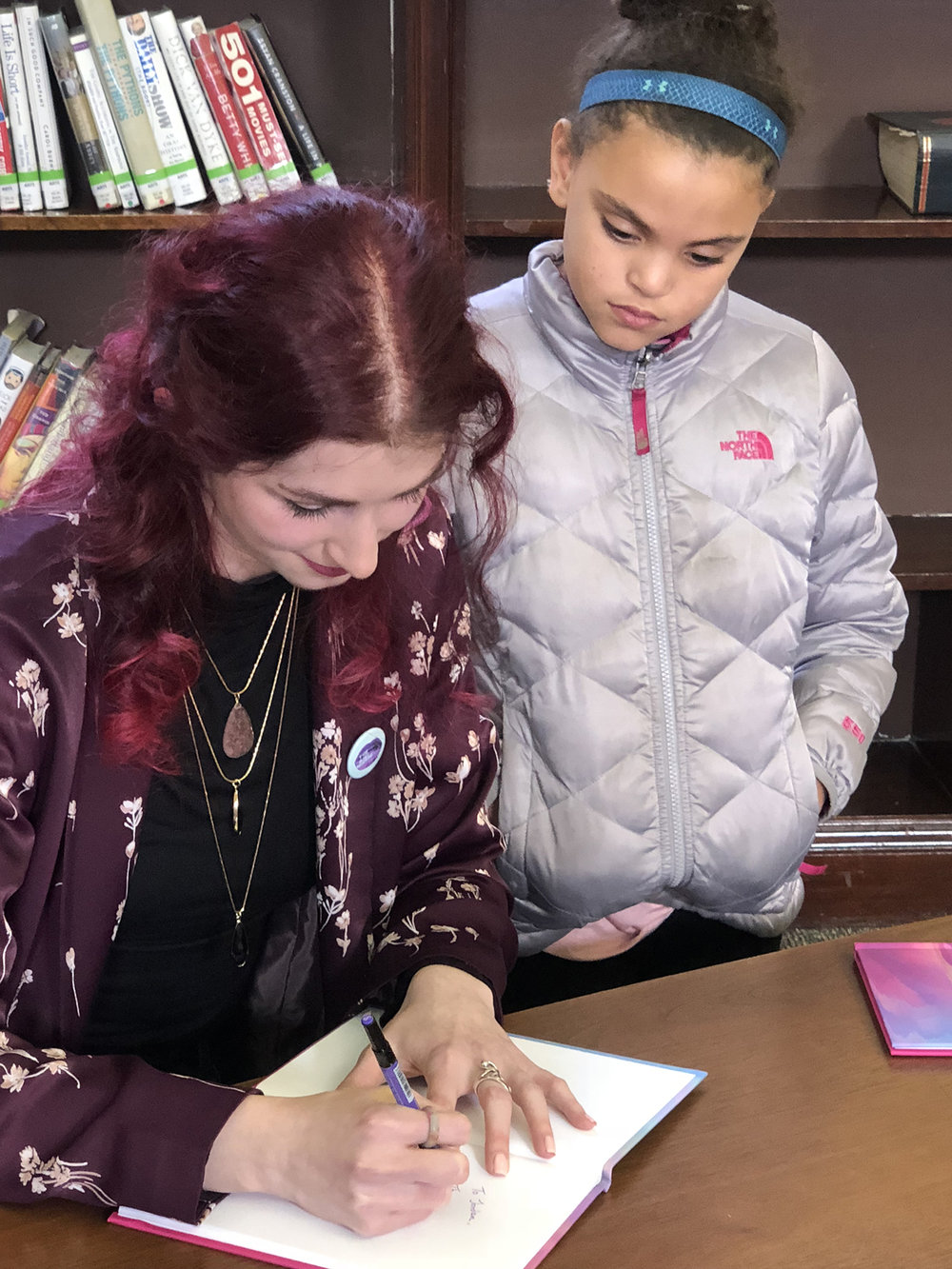 "Geena Matuson ""The Girl Mirage"" with a young fan at her book reading and signing for first book ""Dadalectic: Waking Dream"" at Medfield Memorial Public Library, March 2018. See more @ http://dadalectic.com."