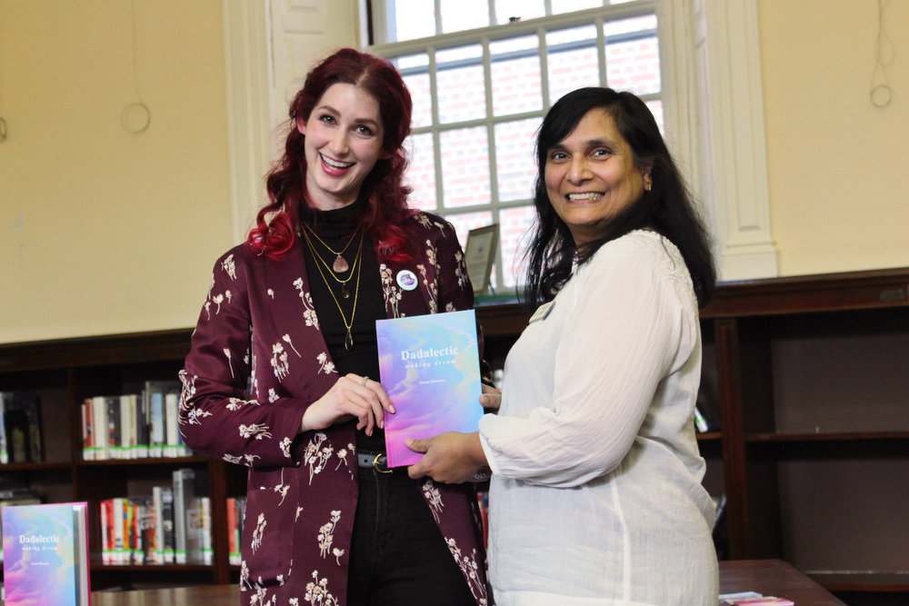 "Geena Matuson super excitedly presents Medfield Memorial Public Library Director Meena Jain with copy of her first book ""Dadalectic: Waking Dream"" at her reading, March 2018. See more @ http://dadalectic.com."