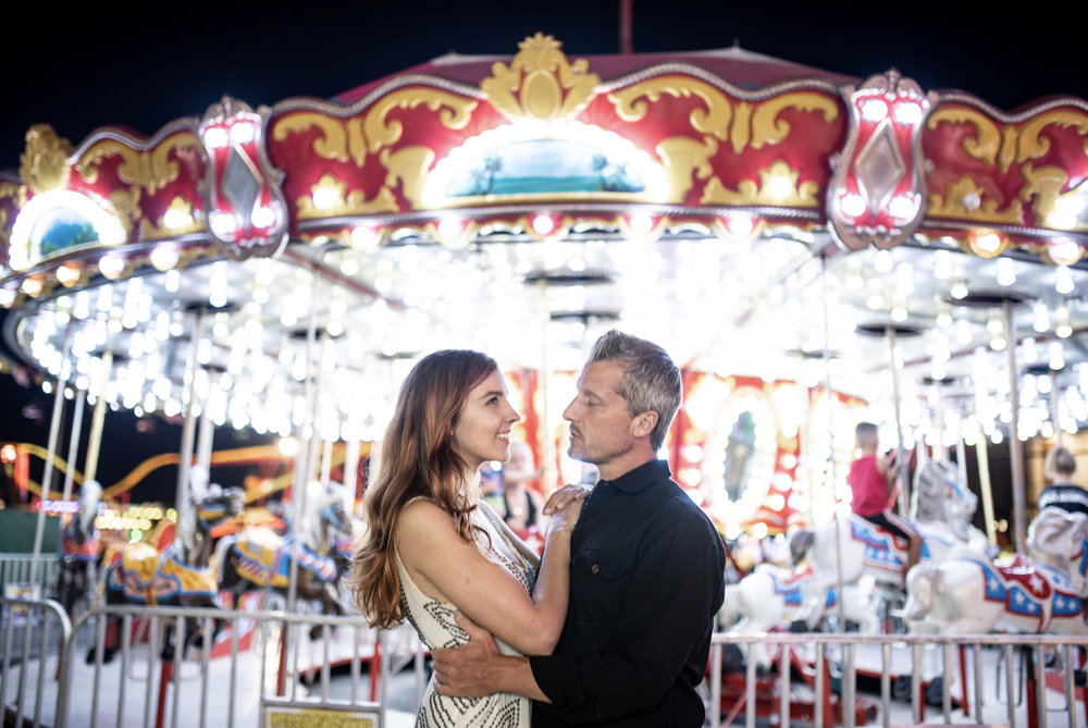 "Zach Murphy of ZAM Photo (@zam.photo) shoot ""A Night at the fair"" with CD Geena Matuson (@geenamatuson) features neon lights in a carnival setting at the New York State Fair, with couple Jake Roberts and Molly Naef. See more @ zamphoto.net."