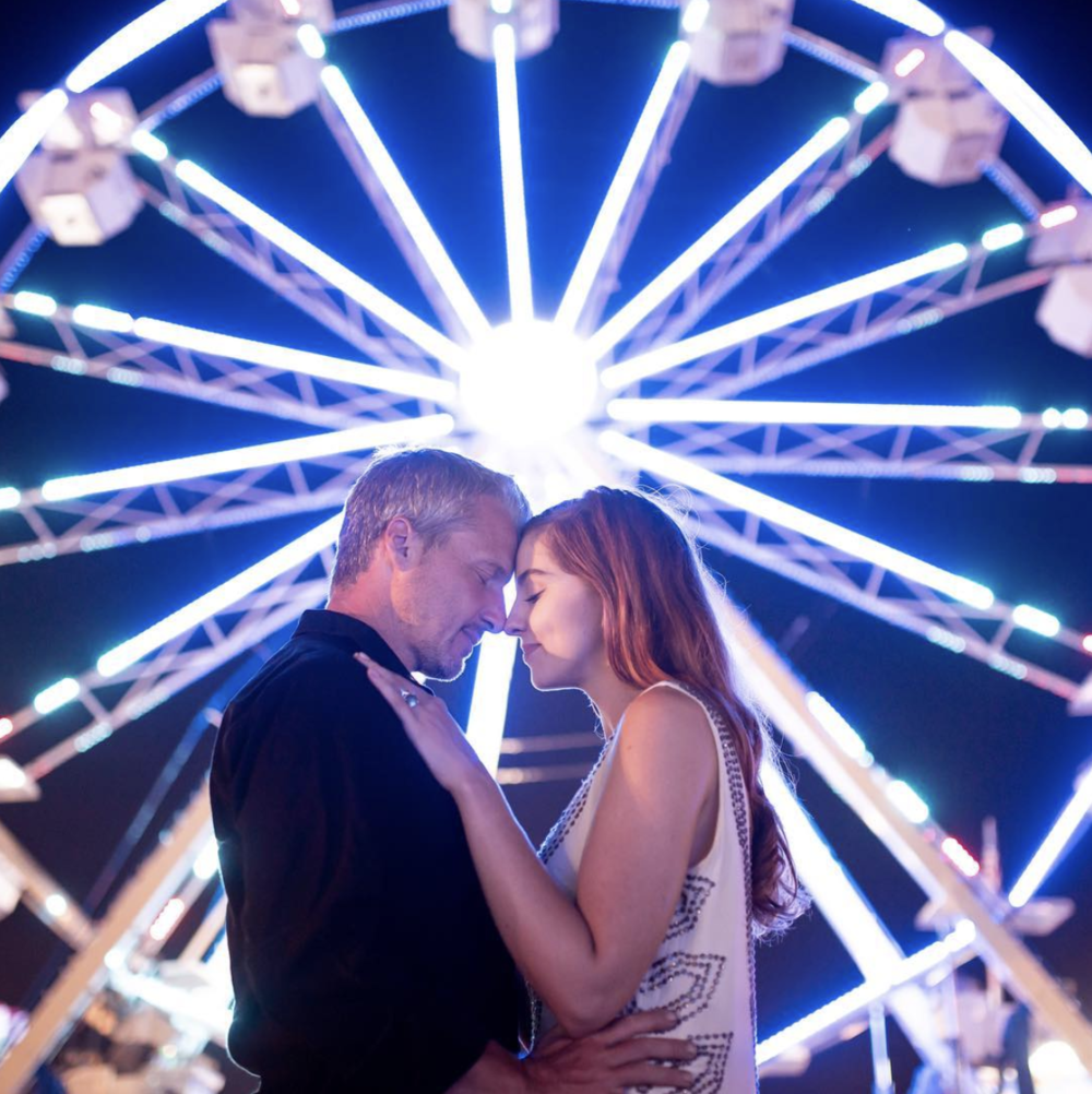 "Zach Murphy of ZAM Photo (@zam.photo) shoot ""A Night at the fair"" features neon lights in a carnival setting at the New York State Fair, with couple Jake Roberts and Molly Naef. See more @ zamphoto.net."