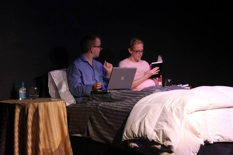 Michael Shallcross and Meg Taylor-Roth. Please note the hand sanitizer on the bedstand. Heh.