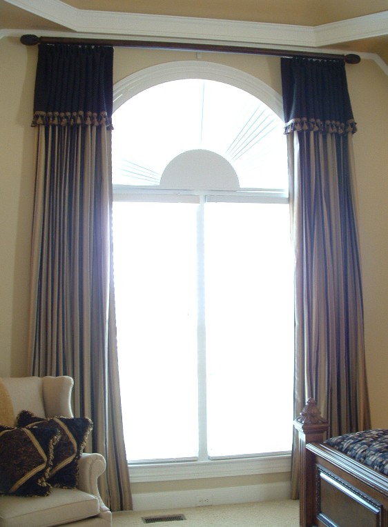 Special window treatments for arched windows the blinds for Motorized shades for arched windows