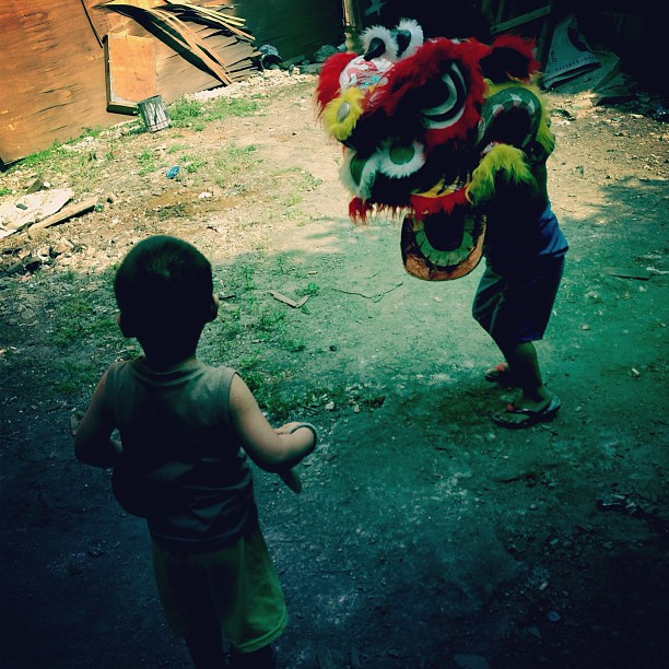 "Children play with a ""Shaitao,"" a mask used for Dragon Dances in Ongpin, Chinatown @rapplerdotcom #chinesenewyear (at Ongpin)"