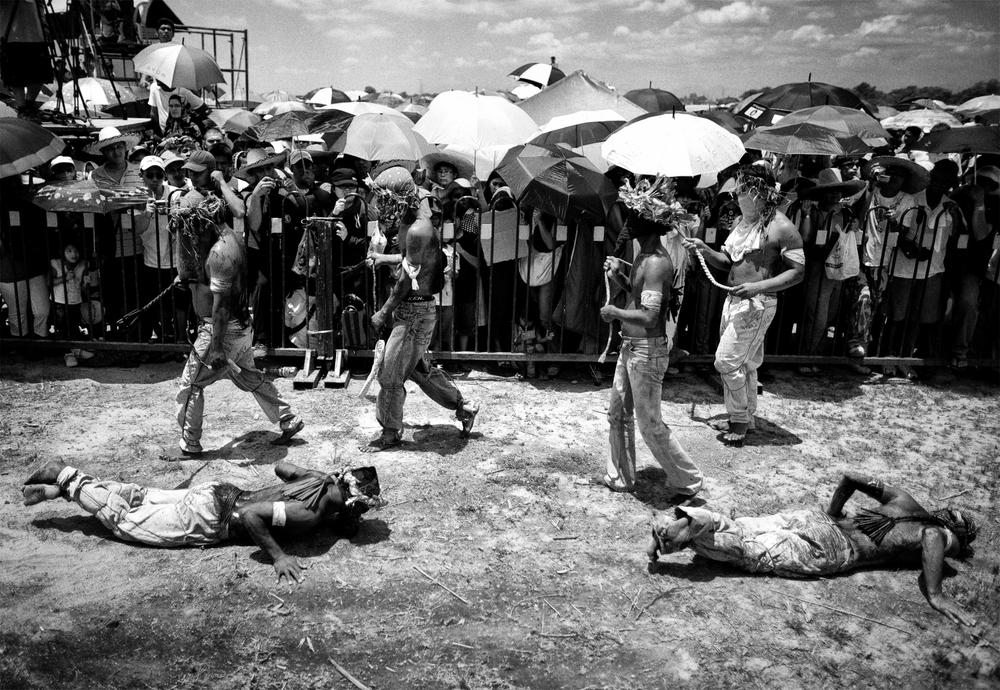 Flagellants whip their back as a voluntary ritual to mark the death of Jesus Christ on Good Friday in Cutud town in Pampanga province, north of Manila