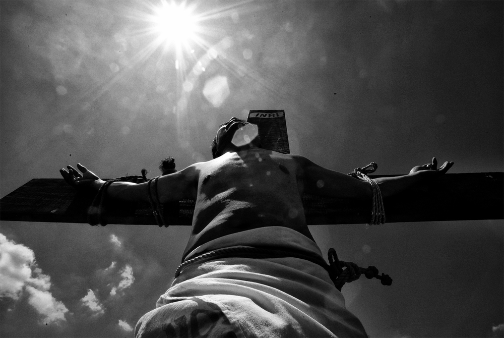 A penitent is displayed to the audience after being nailed on a wooden cross in a voluntary ritual to mark the death of Jesus Christ on Good Friday in Cutud town in Pampanga province, north of Manila