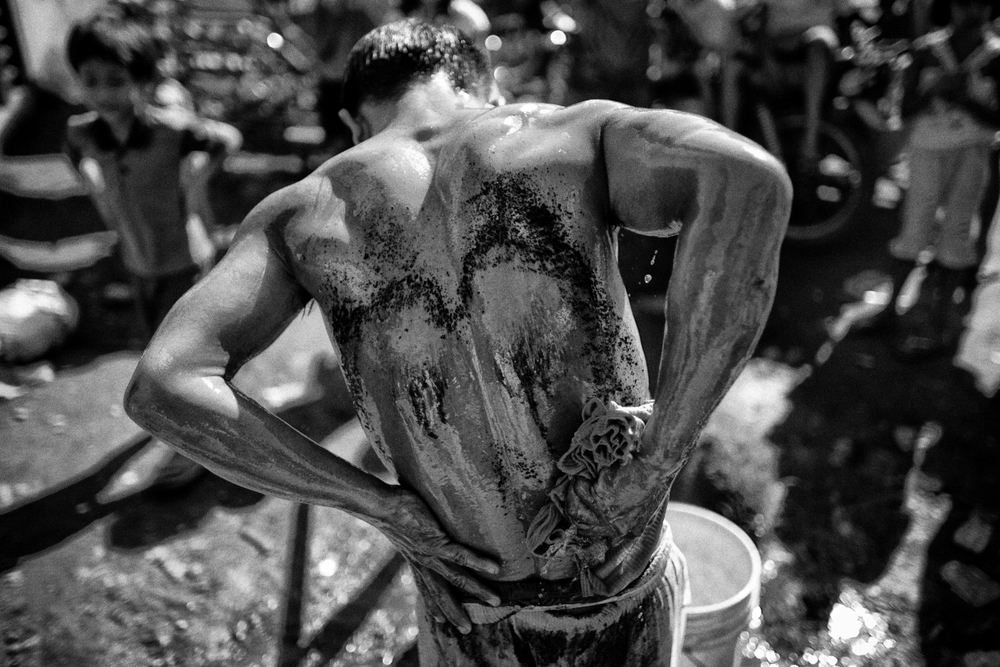 A flagellant cleans his wounds after whipping his back as a voluntary ritual to mark the death of Jesus Christ on Good Friday in Cutud town in Pampanga province, north of Manila