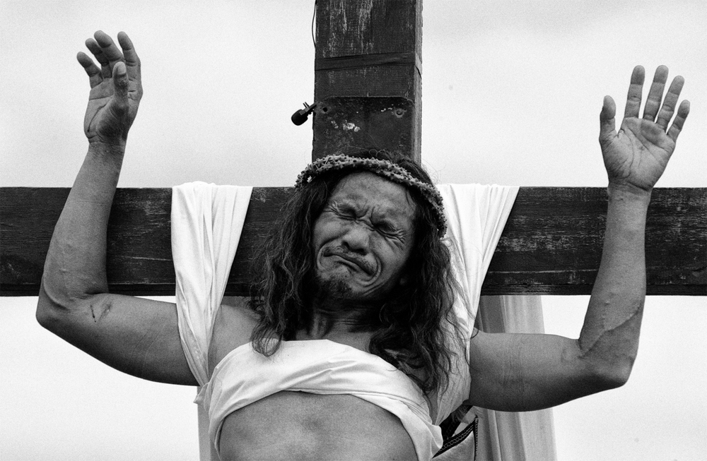 A penitent cries as he shows off wounds on his palm after being nailed on a wooden cross in a voluntary ritual to mark the death of Jesus Christ on Good Friday in Cutud town in Pampanga province, north of Manila. Numerous penitents were nailed to a cross on Good Friday in the most extreme display of religious devotion in the Philippines, a predominantly Catholic country.