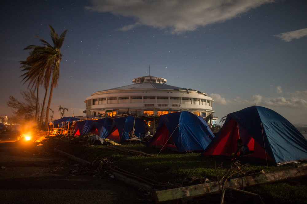 Survivors set up camp outside the sports stadium in Tacloban, Leyte.