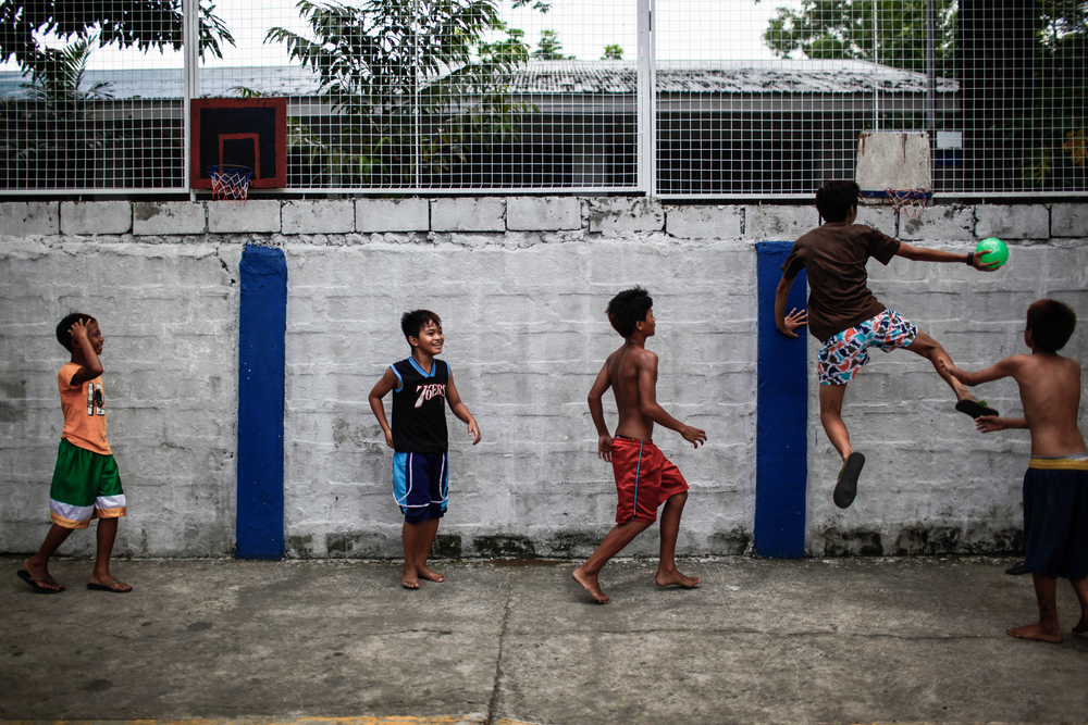 "Children playing at a makeshift ""full court"" in Camp Karingal, Quezon City."