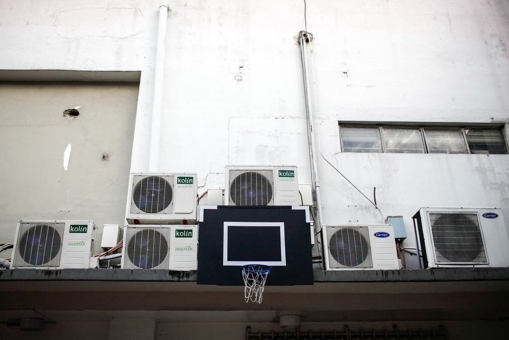 A makeshift basketball court located at an alley behind a corporate building in the financial district of Makati, Metro Manila Philippines.