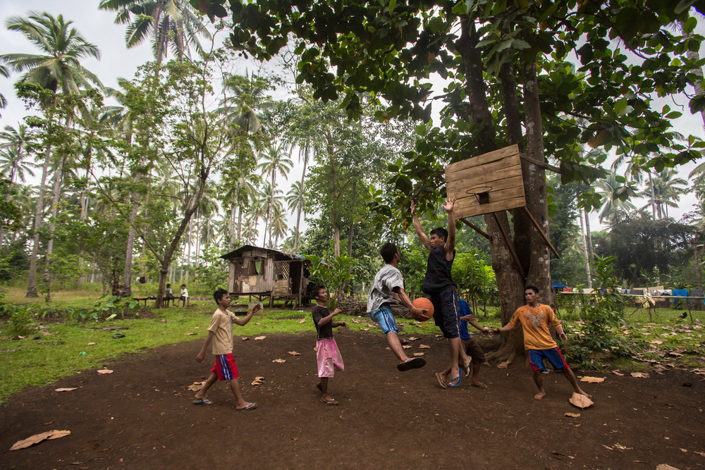 Residents play at a makeshift basketball court in the province of Iligan, Mindanao Region, south of the Philippines.
